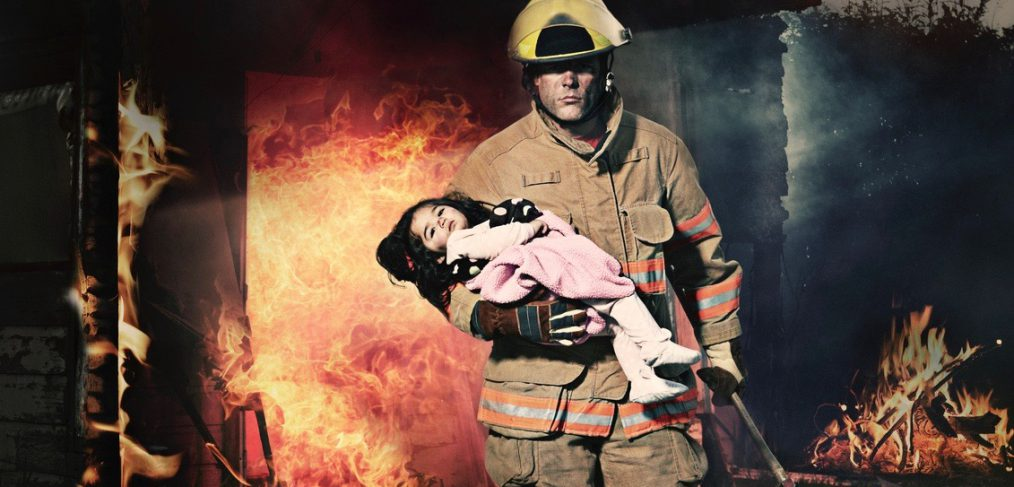 Hero. Fireman Rescuing a Baby From Burning House