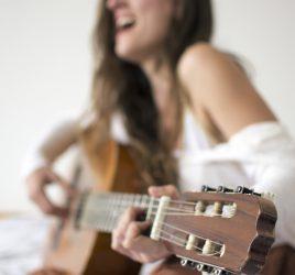 Sound. Woman playing guitar.