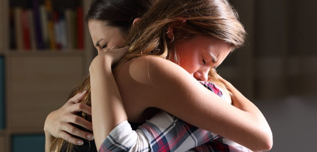 Attachment. Two women hugging.