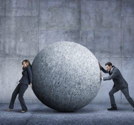 Conflict. Two people working hard on goals given different realities.